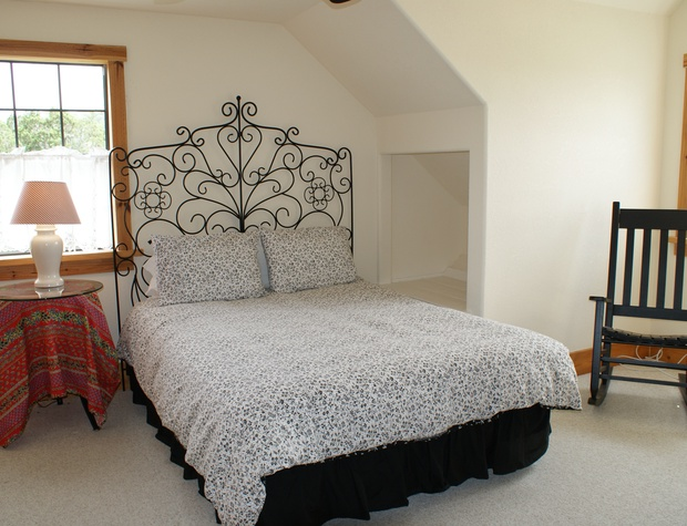 3rd bedroom - located upstairs with a queen bed
