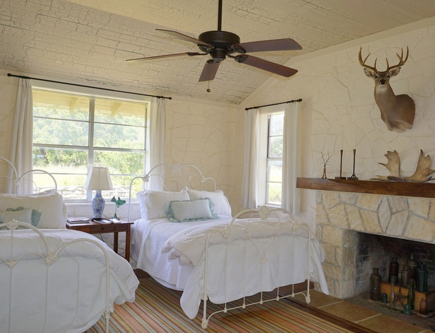 3rd bedroom has lots of windows and a charming decorative fireplace.