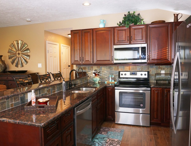 Plenty of counter-space and all new appliances make this kitchen a dream to work in!