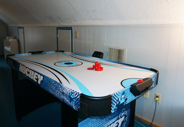 The upstairs open space has a small air hockey table.