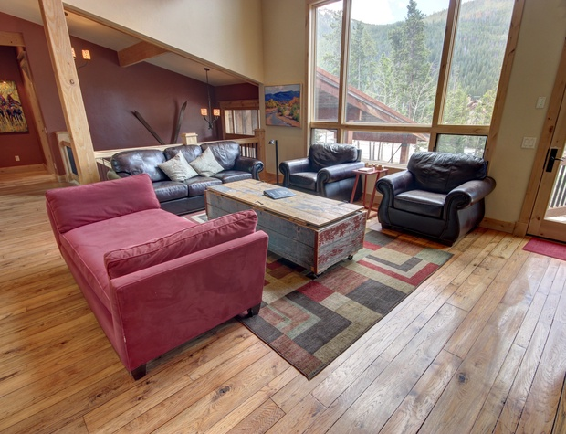 Living room with comfortable leather couches and amazing view