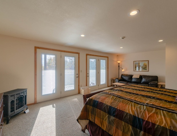 ower king master bedroom opens to hot tub deck