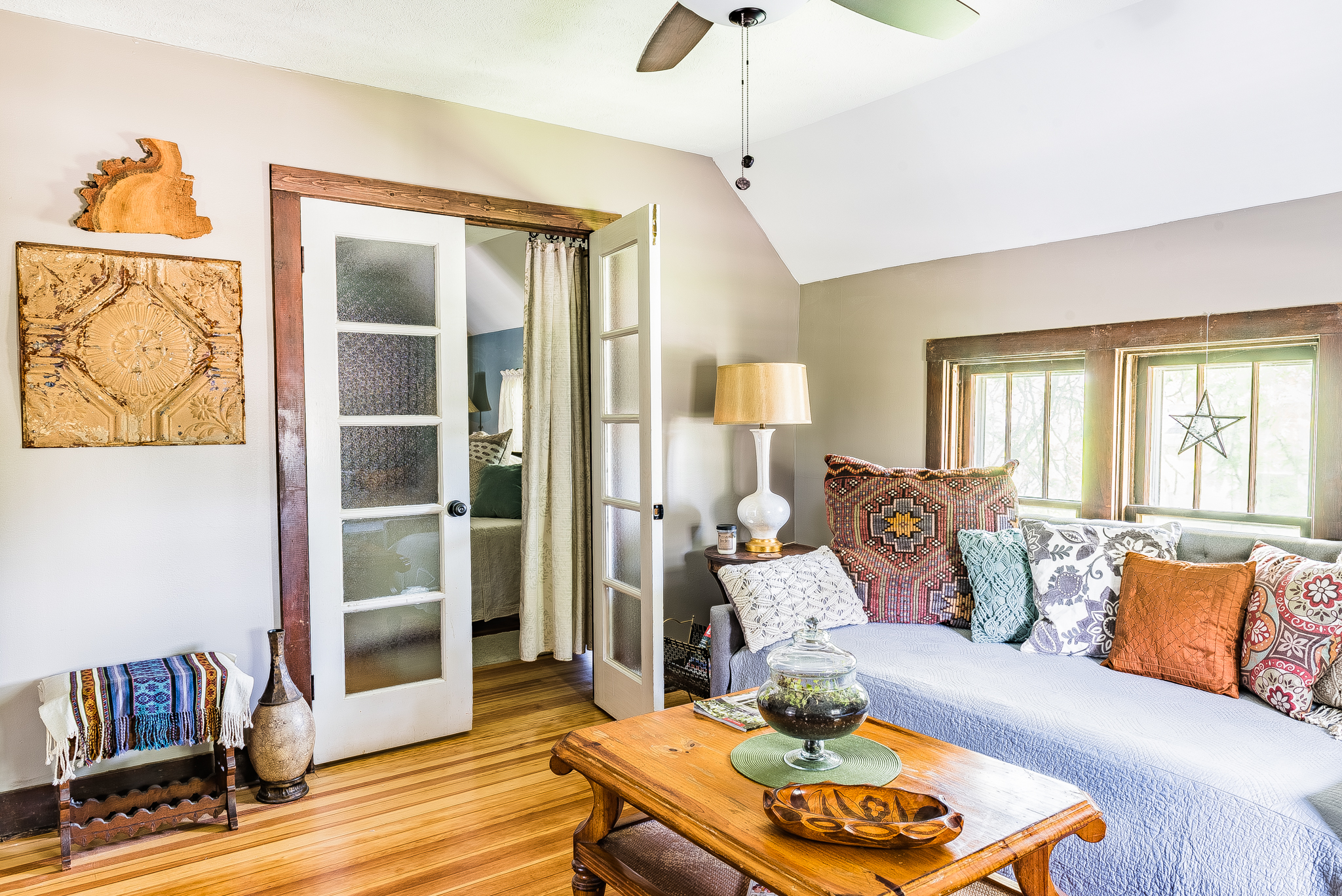 French doors with curtain separating living room and bedroom one
