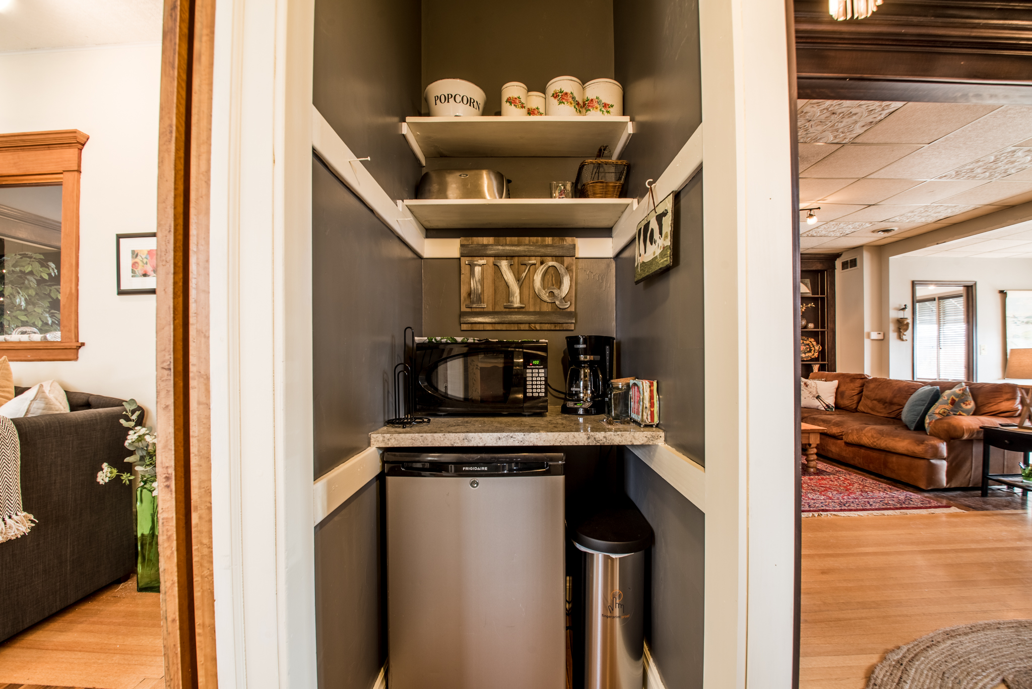 Downstairs kitchenette nook with microwave, toaster, coffee maker, mini fridge/freezer