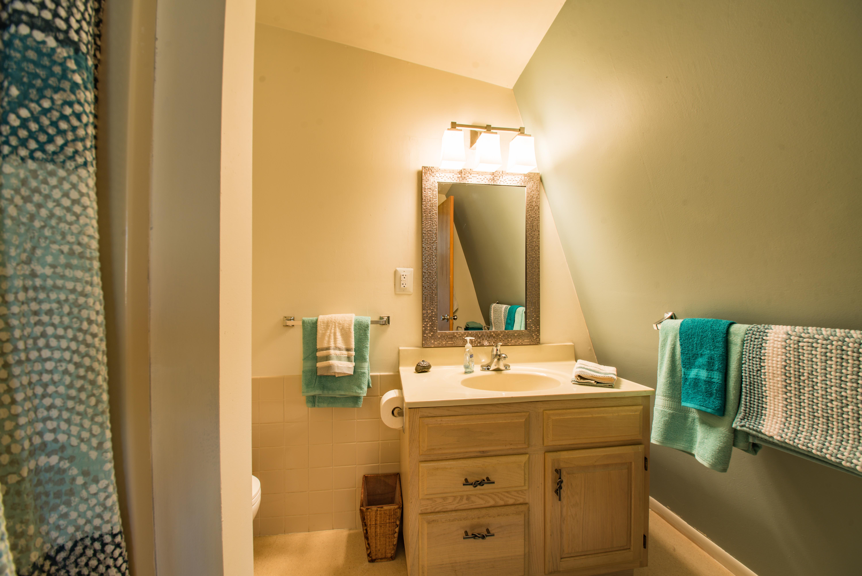 Upper full bathroom with shower stall