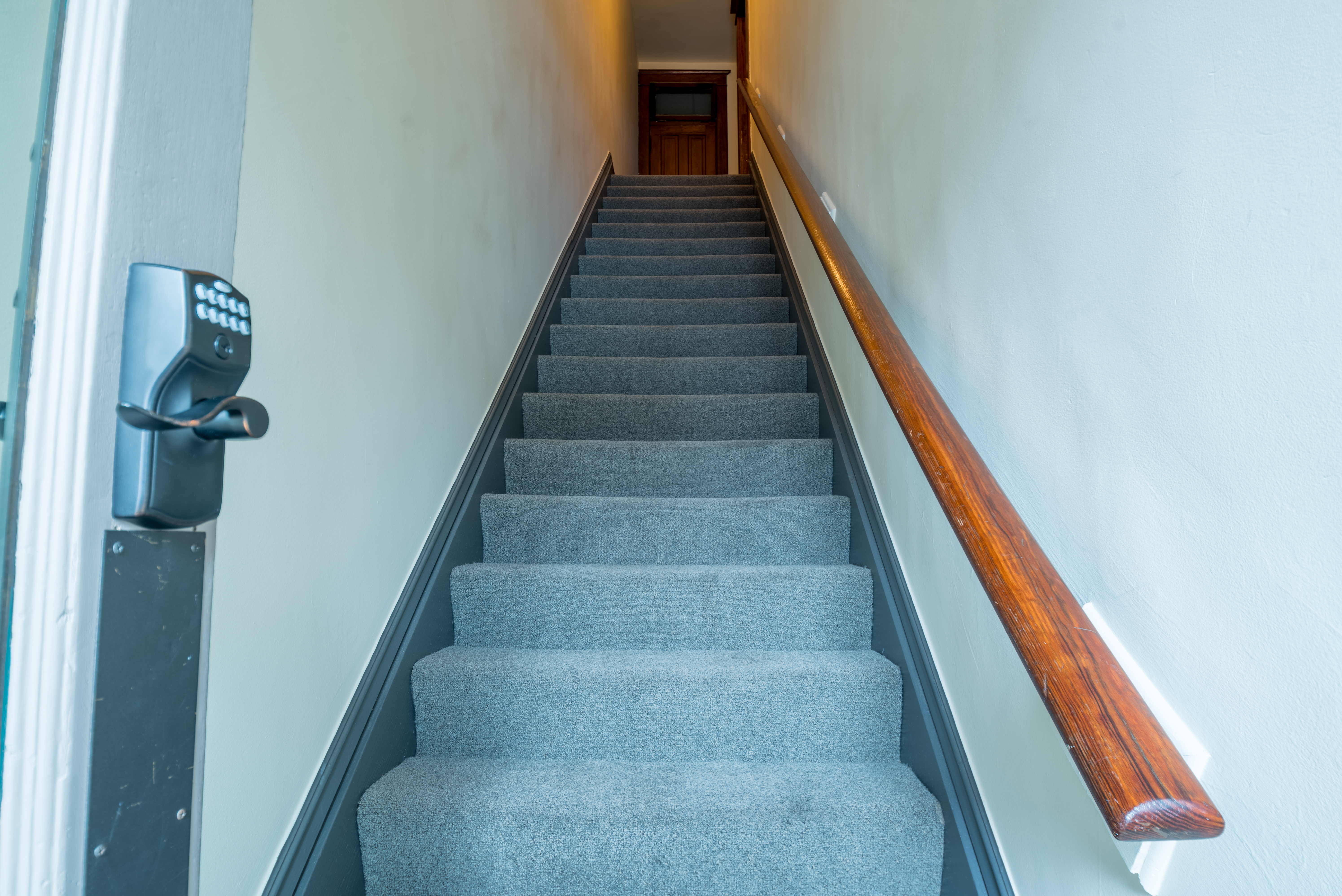 Private stairway leading to studio. Securely locks with code