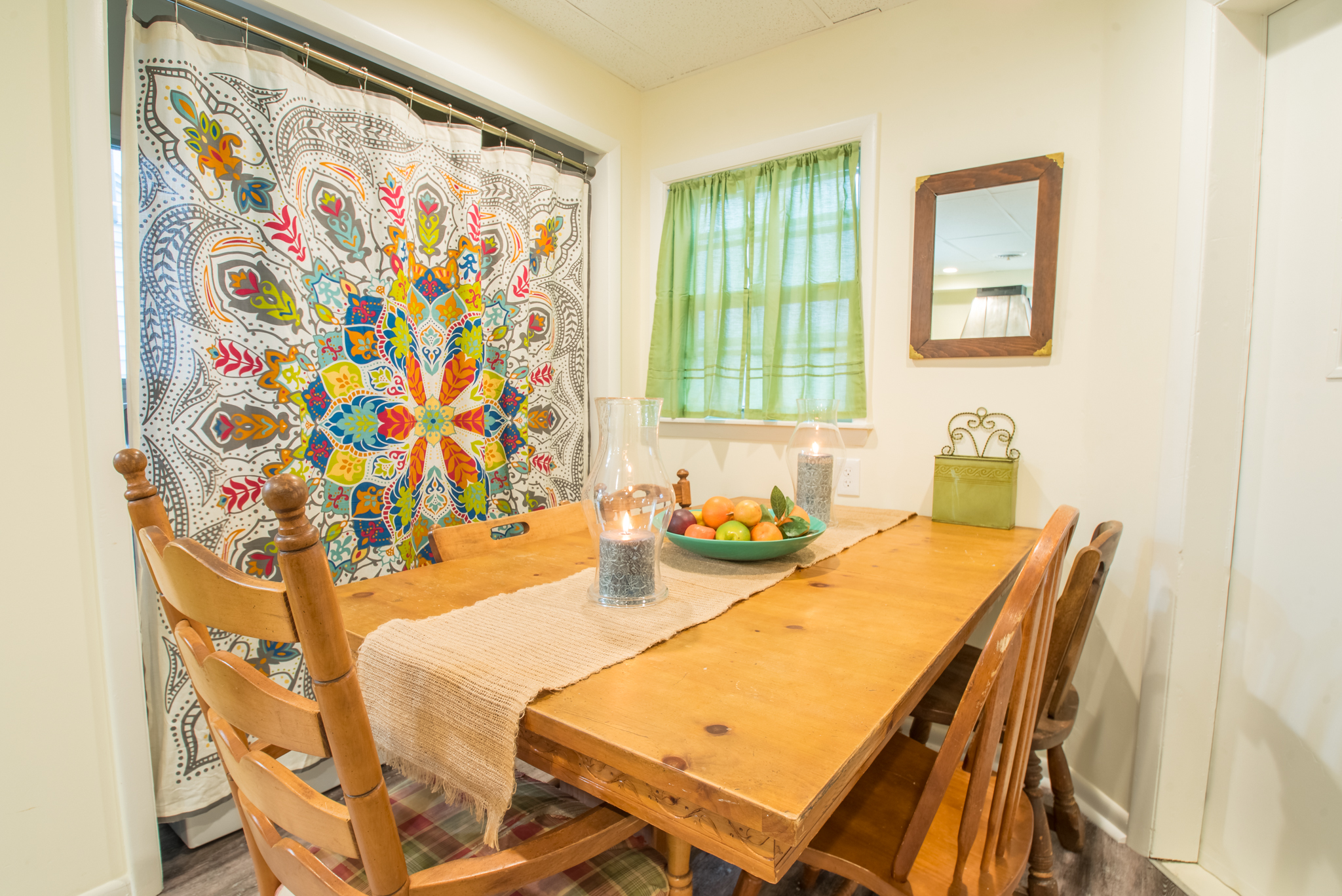 Dining table with seating for six - washer and dryer located behind curtain!