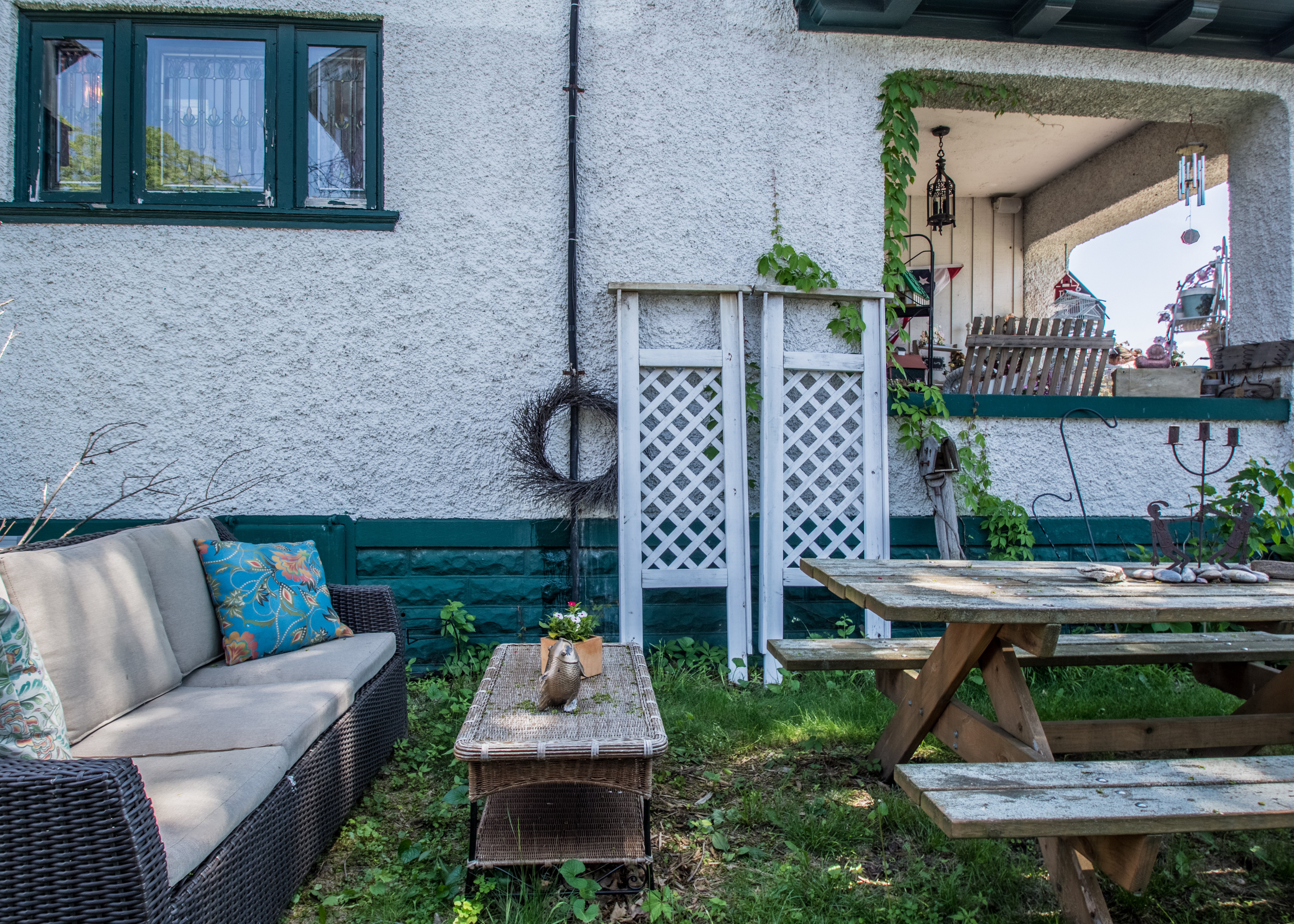Additional outdoor entertaining space in side yard and large front porch