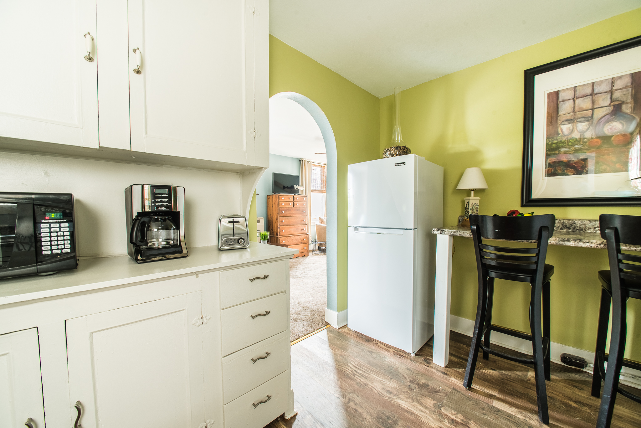 Kitchen amenities include microwave, toaster, coffee maker and refrigerator/freezer (no stove).