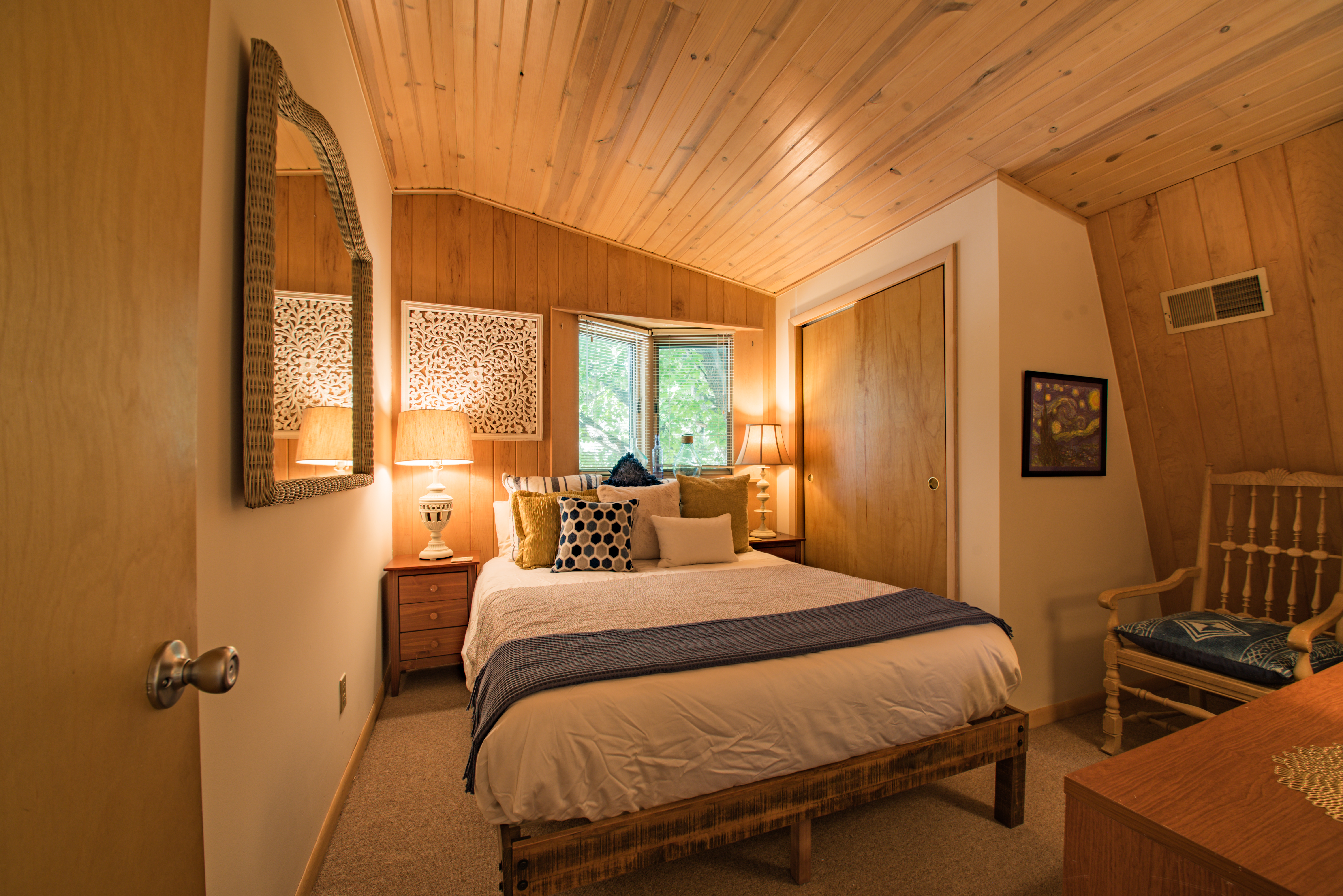 Bedroom with closet and queen bed